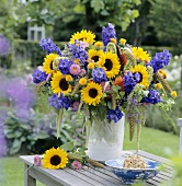 Vase of colourful summer flowers (sunflowers etc.)