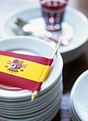 Decoration for a Spanish party: flag on a pile of plates