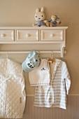 Child's clothing hanging on coat rack