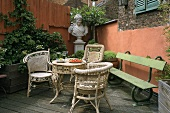 A courtyard with garden furniture