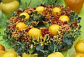 Christmas wreath of cotoneaster berries, holly, lemons