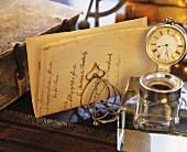 Old desk with letter, inkwell, book