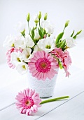 A bunch of flowers on a white wooden table
