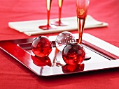 Red and white glass balls as table decoration