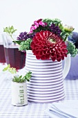 Dahlias, stonecrops, euphorbia and Sweet William in a jug