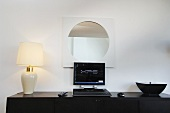 Table lamp and computer on a sideboard