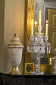 Elegant candle holder with burning candles