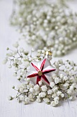 Glass star among baby's breath