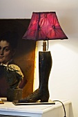 Lamp with a boot-shaped base