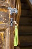 Key in the lock of a rustic house door