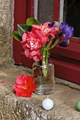 Small posy of flowers on window sill