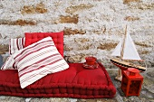 Red floor cushion, maritime decorations