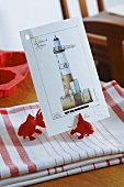Tea towels with fish ornaments and card