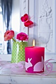 Easter candle and vase of ranunculus on mantelshelf