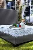 Bed without bedding in garden