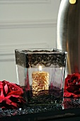 Gold candle in glass