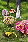 Tables with coloured tablecloths out of doors
