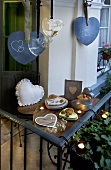 Balcony decorated with hearts, tealights and biscuits