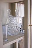 Crystal carafe and glasses on shelf (Château de la Verrerie, France)