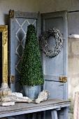 Box tree in metal bucket, door wreath and table decorations