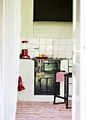 View into a kitchen with a wood-burning stove