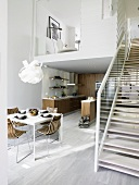 View into a modern flat with kitchen, dining area & gallery