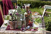 Fritillaries in flip-top bottles & flowerpots (table decoration)