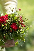 Posy of wild strawberries and roses