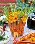 Arrangement of carrots and marigolds
