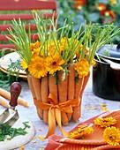 Arrangement of carrots and marigolds