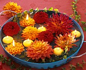 Dahlia flowers with creeping Jenny and floating candles