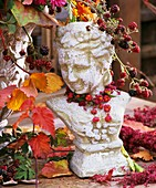 Bust decorated with spindle fruits, blackberries & bell heather