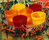 Ornamental peppers & ivy around tray of candle glasses