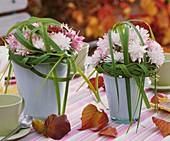Small posies of chrysanthemums with prairie cordgrass