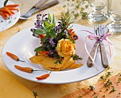 Small arrangement of roses and herbs (plate decoration)