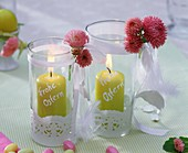 Windlights with bellis and sugar eggs