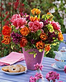 Vase of tulips and hyacinths, vanilla rings and coffee pot