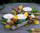 Tea lights with odontoglossum flowers & dwarf bamboo leaves