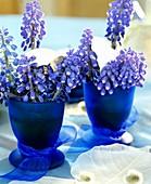 Grape hyacinths with eggshells in eggcups
