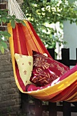 Hammock with cushions in garden