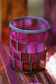 Candle in coloured glass