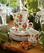 Teatime crockery with a strawberry pattern