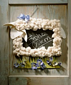 'Frohe Ostern' (Happy Easter) sign hanging on a door