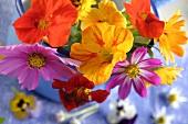 A bouquet of edible flowers in an enamel pot