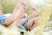 Two pairs of feet in a cornfield