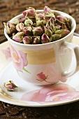 Dried rosebuds in a cup