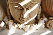 Buddha head with chain of shells