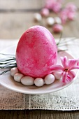 Pink Easter egg with sugar eggs