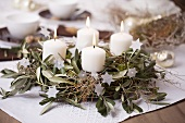Advent wreath of olive sprigs and euphorbia branches