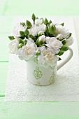 White camellias in a mug